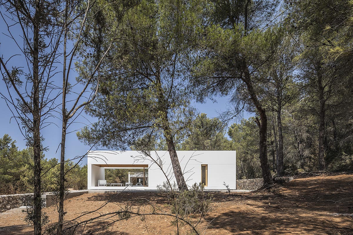 Architecture studio Marià Castelló Architecture has completed a family house designed with fragmented all-white color volumes on the island of Ibiza, Spain